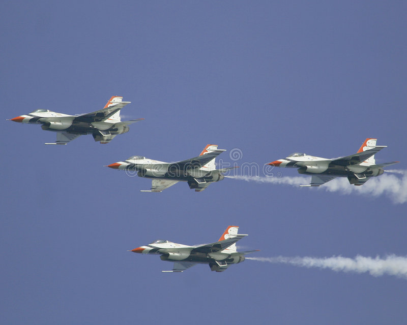 USAF Thunderbirds. Thunderbird f16's flying in perfect formation. The F-16 Fighting Falcon is a multirole jet fighter aircraft developed by General Dynamics and stock image