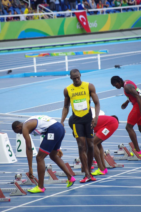 Usain Bolt at 100m start line at Rio2016 Olympics. Usain Bolt, a Jamaican sprinter at 100m starting blocks during Round 1, heat 7 at Olympic Stadium in Rio de royalty free stock photos