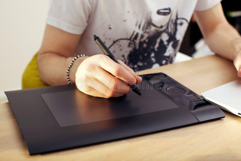 Usando la tablilla de gráficos del Touchpad imagenes de archivo