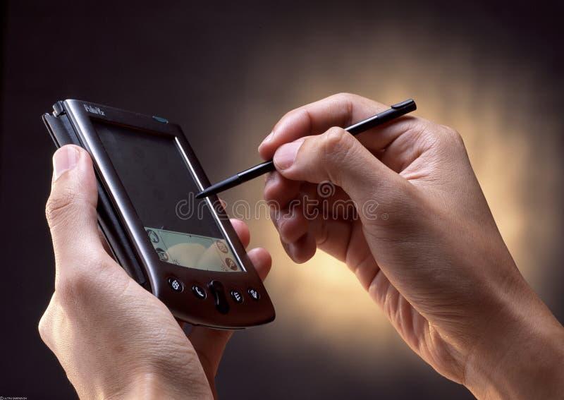 Usando PDA imagens de stock