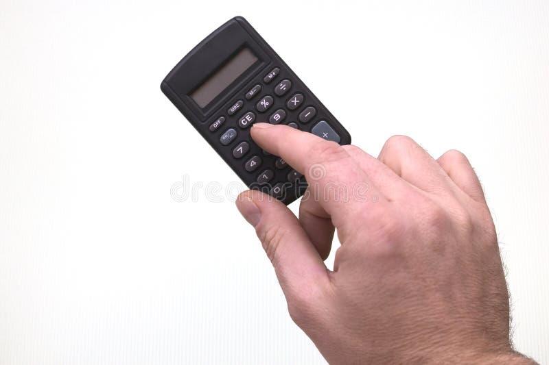 Usando una calculadora fotografía de archivo