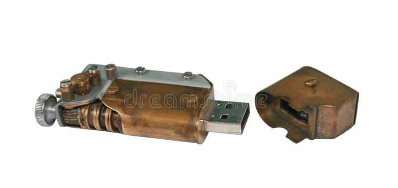 USB闪光驱动由老机械做成的零件 库存照片