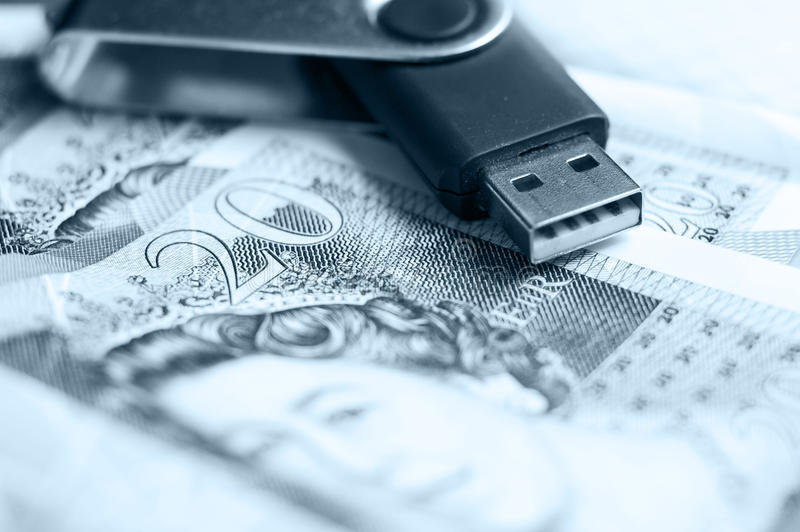 USB and 20 Pound Notes royalty free stock photo