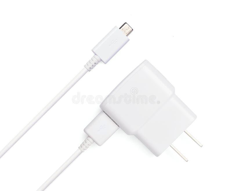 USB cable plug with USB power plug adaptor. Close up white USB and micro USB cable plug with USB power plug adaptor, isolated on white background stock image