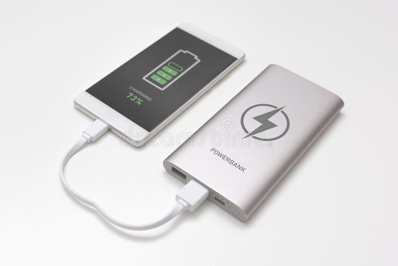 USB charger plugged in to smart phone royalty free stock photo