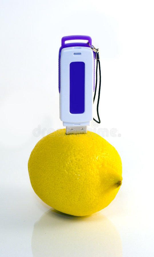 USB Flash Drive In Lemon Royalty Free Stock Image