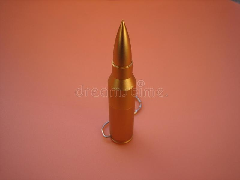 Bullet USB flash memory. Usb flash memory in the form of a gold bullet. Unusual flesh memory design faithful to the original stock photography