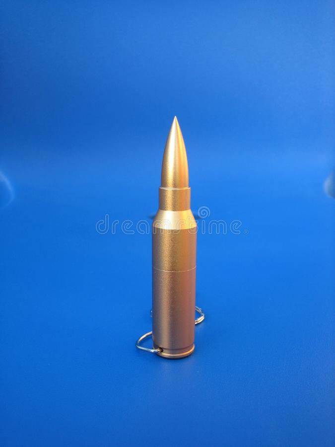 Bullet USB flash memory stick. Usb memory in the form of a gold bullet. Remarkable flesh memory design stock photo