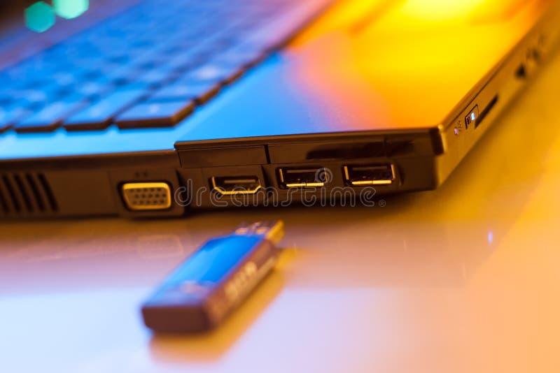 Usb memory stick. Closeup shot of usb memory stick near laptop stock photos