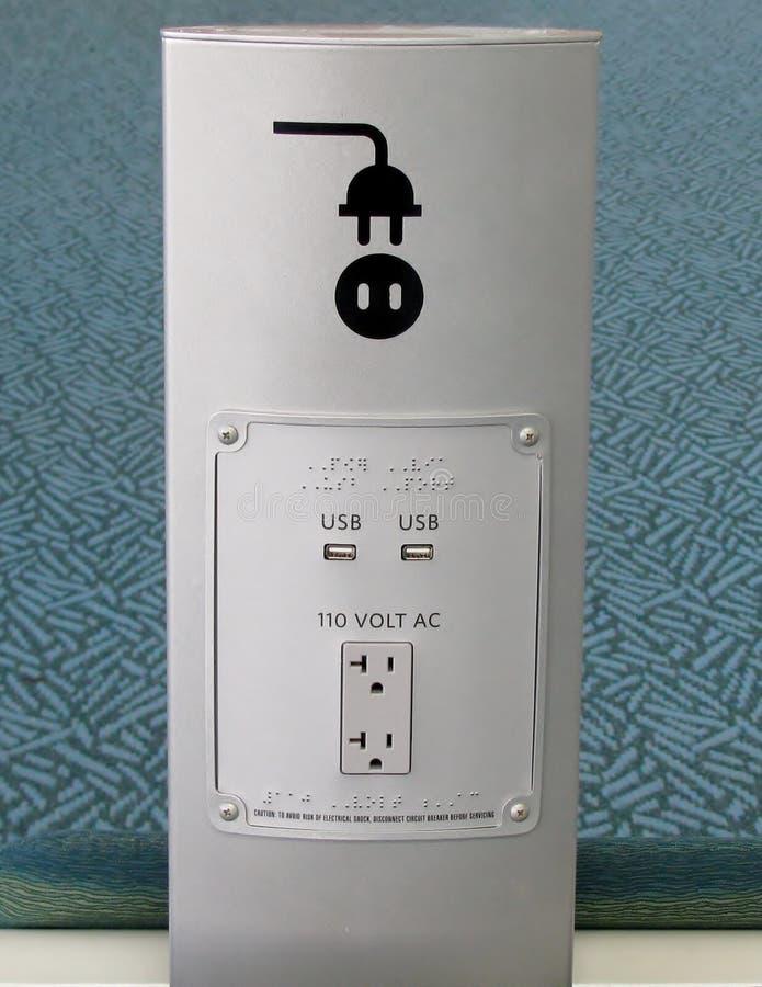 USB portar och hålighet för elektrisk propp arkivbilder