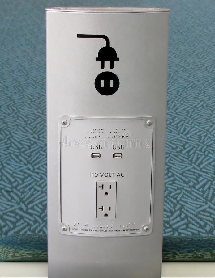 USB ports and electric plug socket stock images