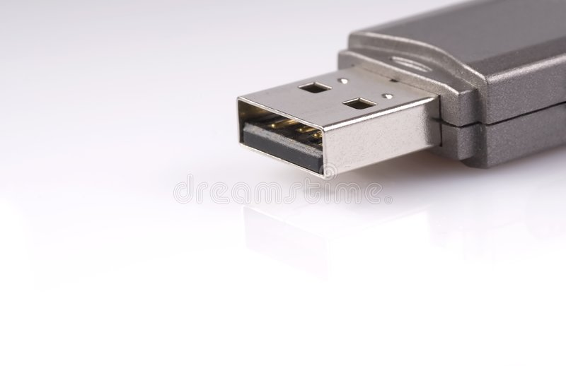 USB Stick. Close-up of usb stick with reflection, isolated over white stock images