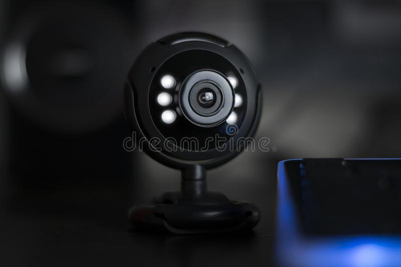 Usb web camera webinar conference call. Black usb web camera with lights; webinar conference call concept stock photo