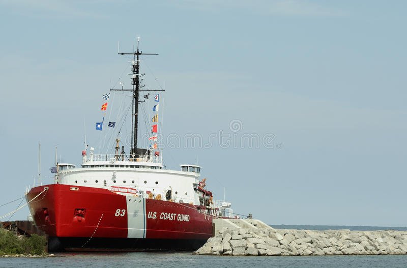 USCG Cutter Mackinaw WAGB 83. Built in 1944 at a cost of $10 million. U.S. Coast Guard cutter Mackinaw had six ten-cylinder engines that enabled it to cut stock photos