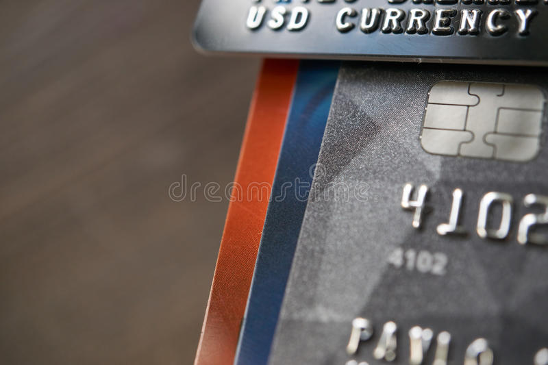 Usd currency payment credit cards with accumulation. Bunch of us dollars currency payment credit cards platinum customer service. chipped and secured stock photo