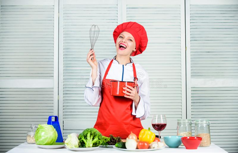Use hand whisk. Woman chef hold whisk and pot. Girl in apron whipping eggs or cream. Start slowly whisking or beating royalty free stock photo