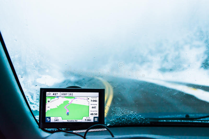 Use navigator on the road with snow when driving in snow mountain. royalty free stock photos