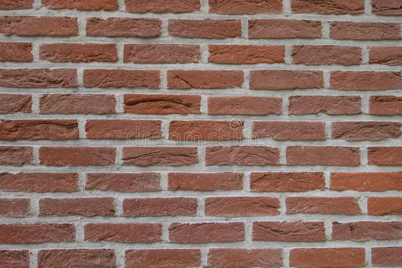 Red brick wall with grey mortar texture stock photo