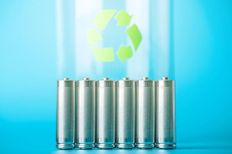 Proper disposal of toxic to the soil environment and batteries. Recycling of harmful substances for ecological. Used AA and proper disposal of toxic to the royalty free stock images