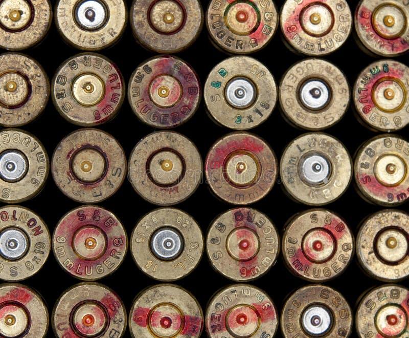 Used ammo shells. Used 9mm ammo shells background stock photos