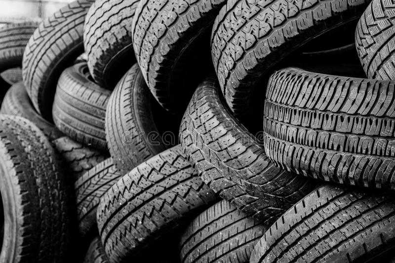 Used auto tires stacked in piles. Worn auto tires stacked at recycling facility royalty free stock images