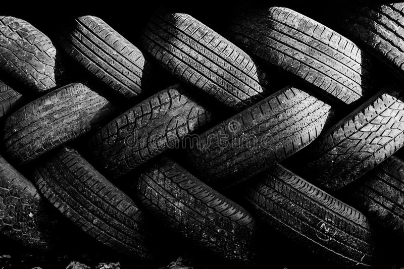 Used auto tires stacked in piles. Worn auto tires stacked at recycling facility royalty free stock photos