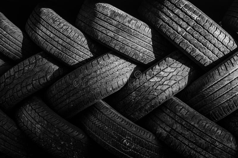 Used auto tires stacked in piles. Worn auto tires stacked at recycling facility stock photos