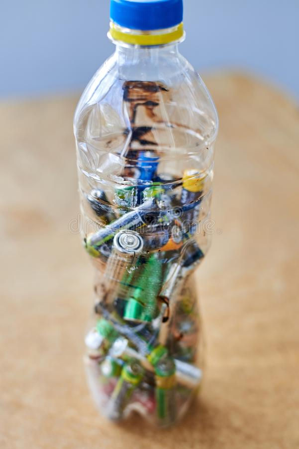 Used batteries in a plastic bottle, the topic of sorting garbage stock image