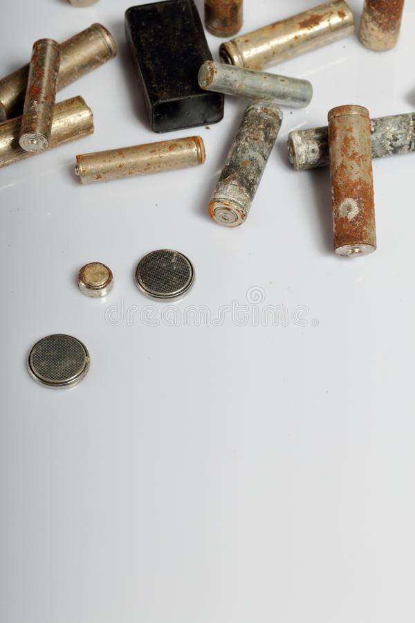 Used batteries on a white background. Recycling waste batteries. Environmental Protection. Earth Day.  stock image