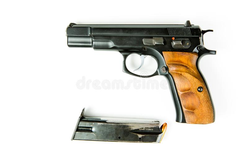 Used black semi automatic pistol and scraped magazine royalty free stock image