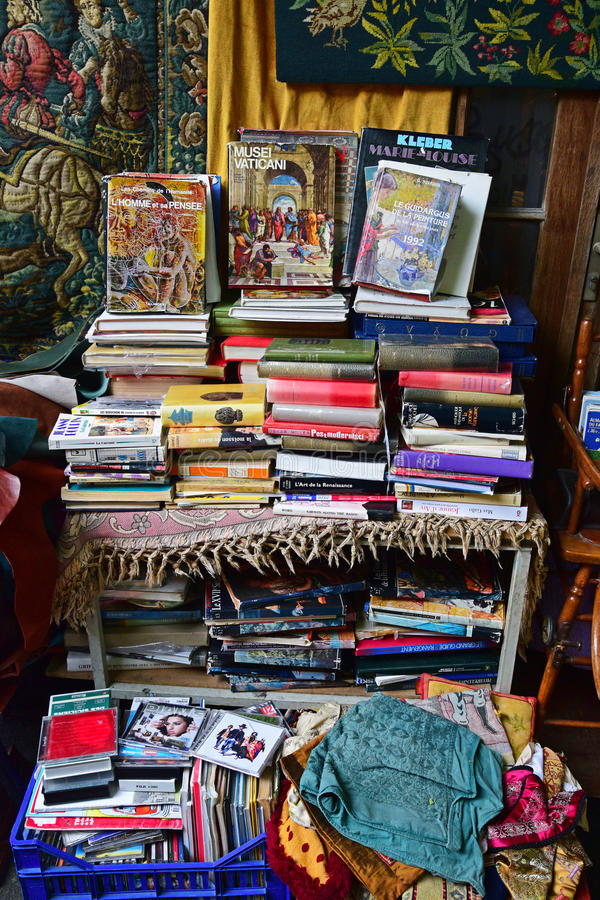 Used books, compact disc and carpets in flea market. Used books, compact disc and carpets for sale in flea market. This was taken in one of the shops in an alley royalty free stock images