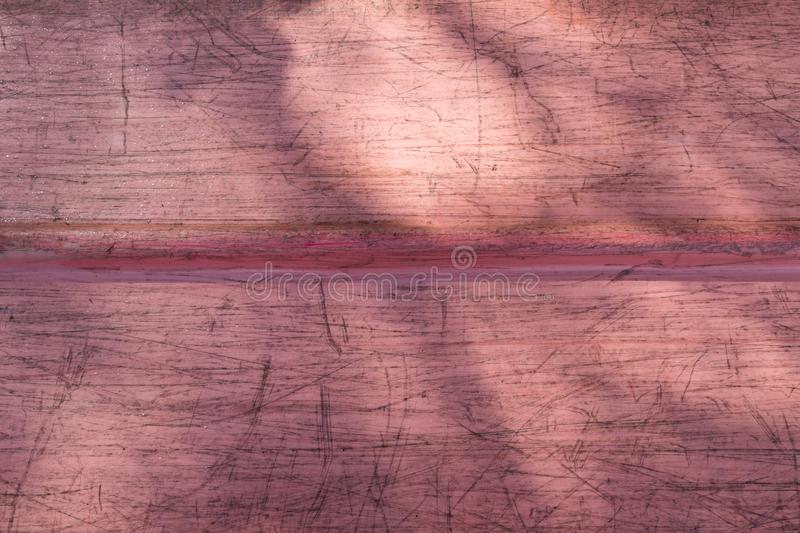 Used canoe bottom with sunlight and shadows stock image