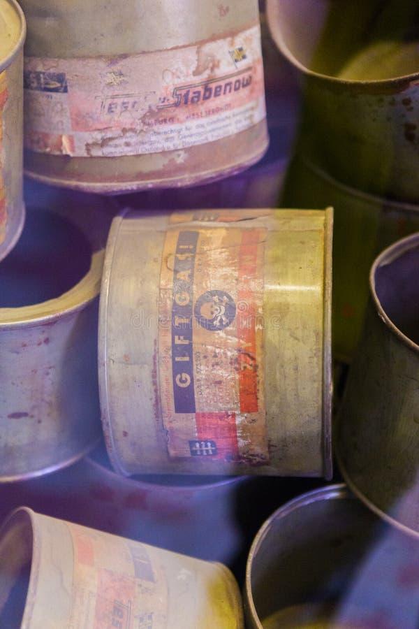 Used cans of Zynklon B displayed in Auschwitz Birkenau museum stock photo