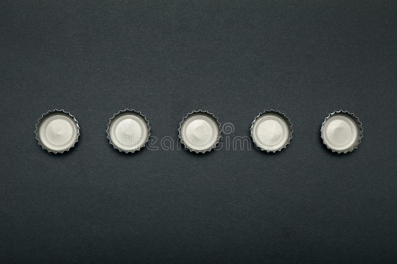Used caps from alcoholic beverages. Alcoholism, drunkenness.  royalty free stock photography