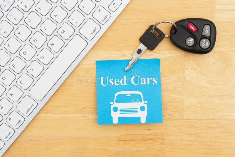 Used car message with car keys with a keyboard on a sticky note. For your finding used vehicles online message stock photos