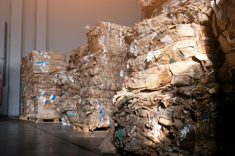 Used cardboard polyethylene and plastic pressed into bales at finished products warehouse on modern waste sorting and processing stock images