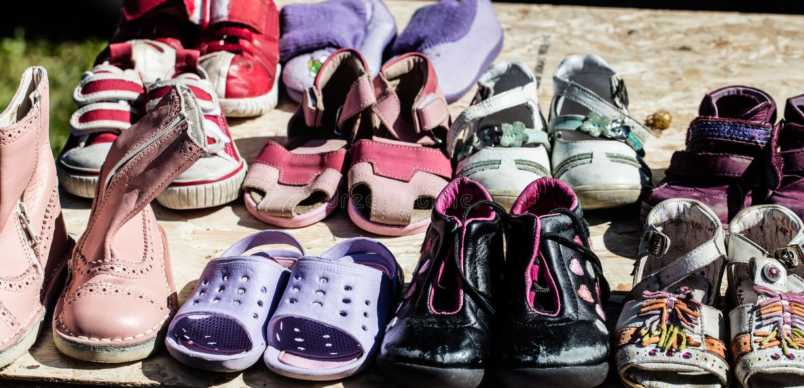 Used child and baby shoes for reusing at flea market royalty free stock photo