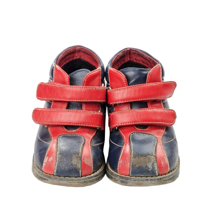 Used child shoes. Used red-blue child shoes isolated on white royalty free stock photos