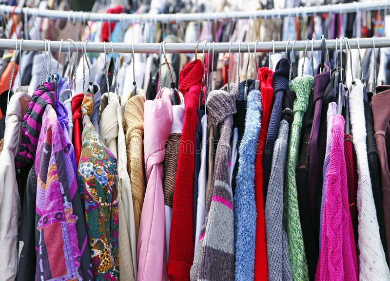 Used clothes on rack royalty free stock photo