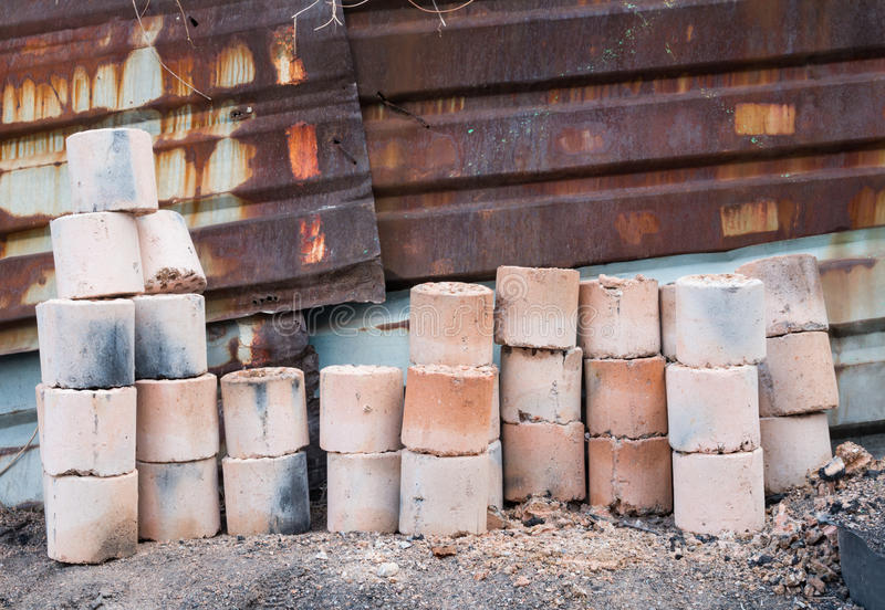 Used coal briquette. On the street royalty free stock images
