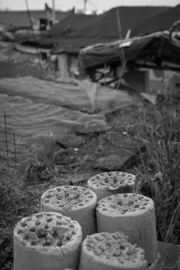 Used coal briquette. On the street stock photo