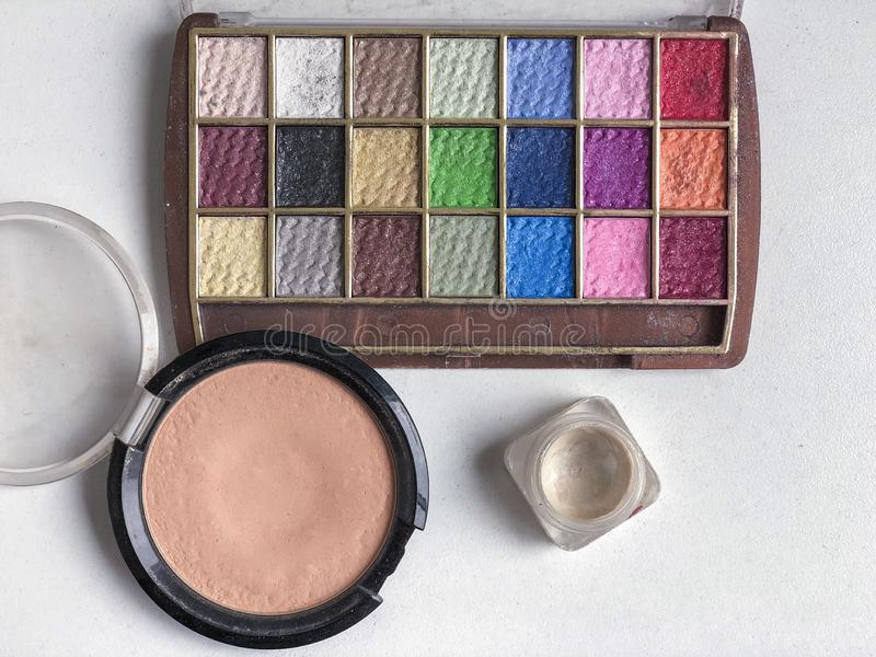Used color makeup cosmetics on a table. Used color makeup cosmetics on table with copy space stock photography