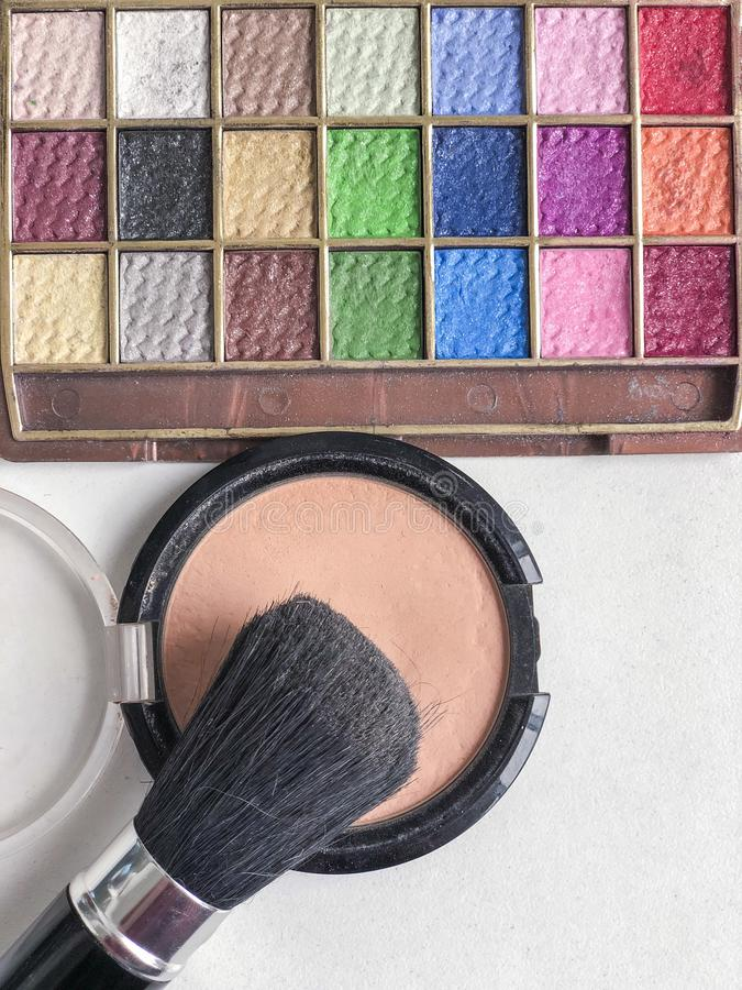 Used color makeup cosmetics on a table. Used color makeup cosmetics on table with copy space stock images