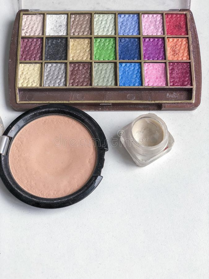 Used color makeup cosmetics on a table. Used color makeup cosmetics on table with copy space royalty free stock photography