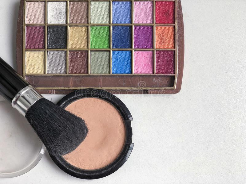 Used color makeup cosmetics on a table. Used color makeup cosmetics on table with copy space stock image