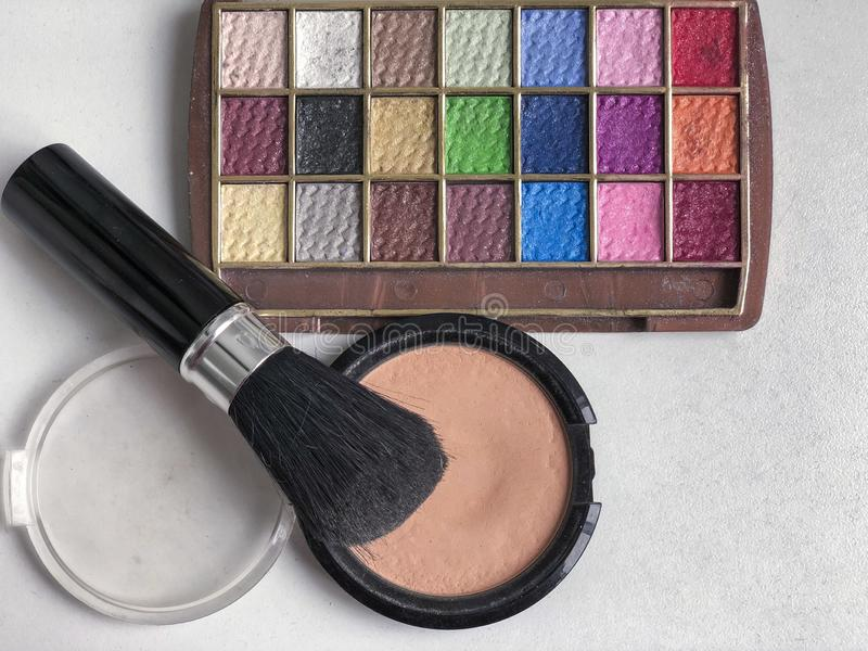 Used color makeup cosmetics on a table. Used color makeup cosmetics on table with copy space royalty free stock images