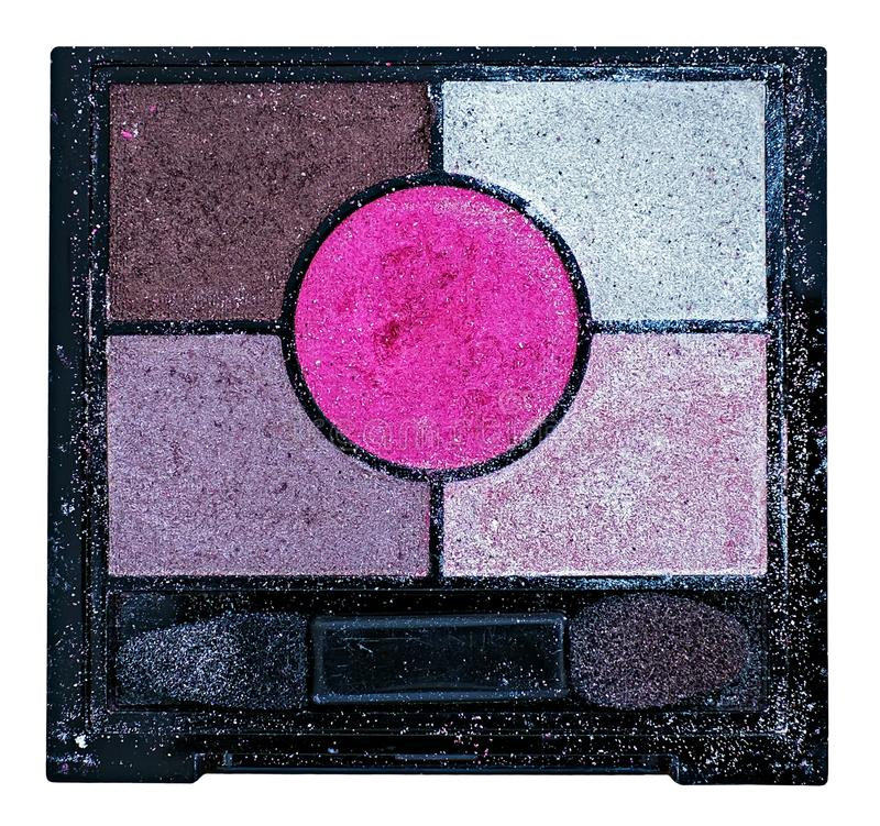 Used colorful cosmetic eyeshadow palette makeup set. Close view royalty free stock photo
