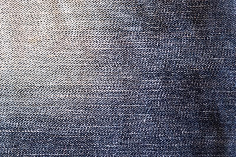 Used faded blue jeans, denim jeans background. Jeans texture, fabric. stock image