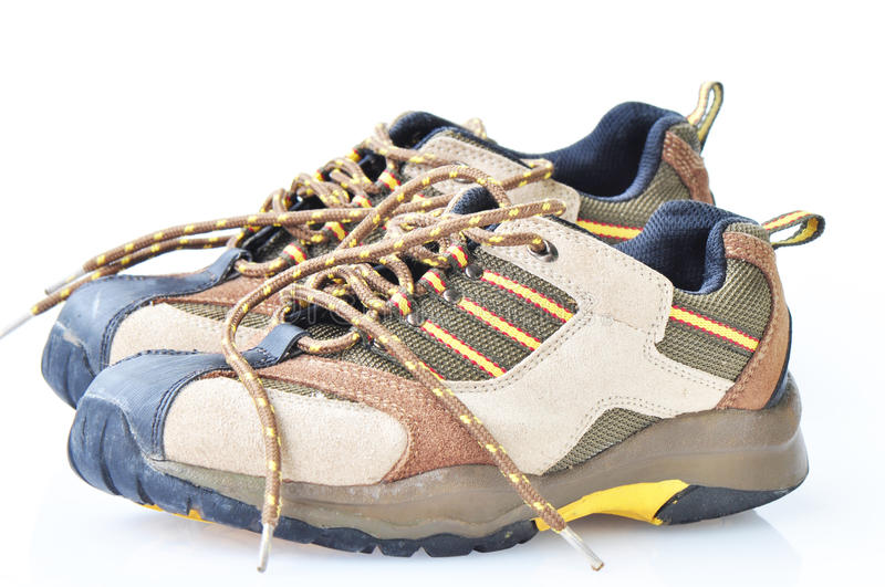 Used hiking boots. Pair of brown used hiking boots royalty free stock images