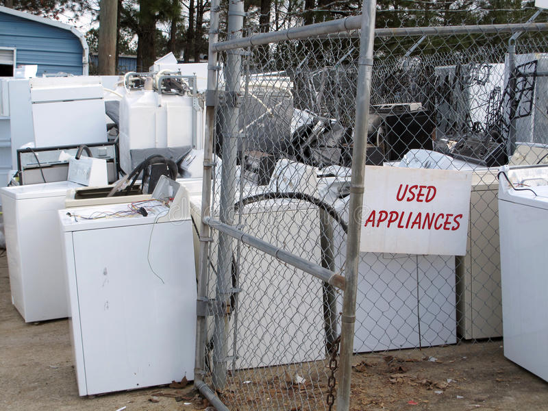 Used Home Appliances. A collection of old used reconditioned home appliances royalty free stock photo